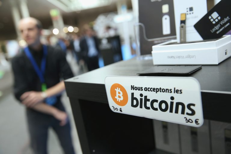 hanover-germany-march-16-a-sign-in-french-that-reads-we-accept-bitcoins-hangs-at-a-display-o-768x512.jpeg